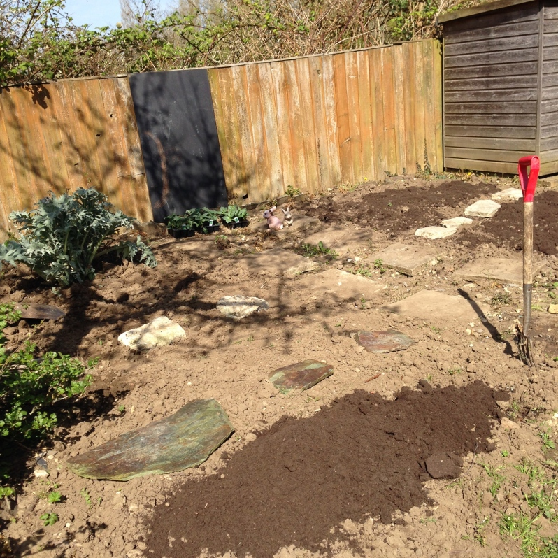 Mixing in some fresh compost in the ground as existing soil is too hard and muddy.