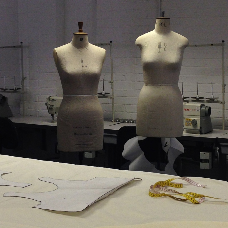 Tracing neck, arm and neck hole to get started (we were making a dress) and start subtracting shapes form the fabric.